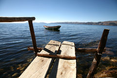 Rowboat. Pier and rowing boat on Lake Titicaca in Bolivia stock photo