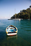 Rowboat. A rowboat in the water with some sailboats in the background royalty free stock photo