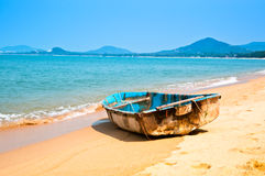 Rowboat on the Beach. A lone rowboat on a beach in Thailand Royalty Free Stock Photography