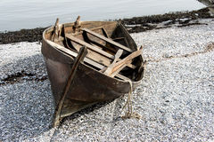 Rowboat on beach in Oslo Stock Photography