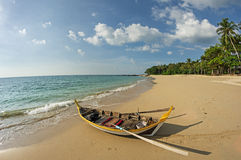 Rowboat On Beach Stock Images