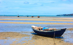 Rowboat. Blue boat on the beach Stock Image