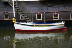 Rowboat. Bound to a old ship Stock Images
