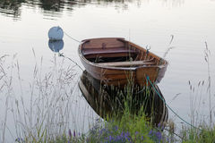 Rowboat in calm water in the harbour royalty free stock photography