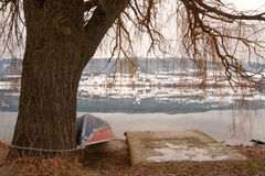 Finished for the Season. A rowboat chained up to a tree for the winter Stock Images