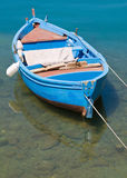 Rowboat in clear sea. Royalty Free Stock Photography