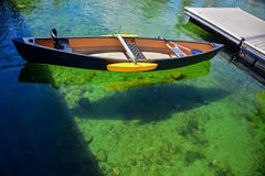 Rowboat on the clear water Stock Image
