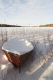 Rowboat covered in Snow Stock Photography
