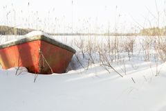 Rowboat covered in Snow Royalty Free Stock Photo