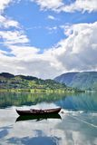 Rowboat in a fjord. Single rowboat in a fjord in Ulvik, Norway. Beautiful scenery Stock Photos