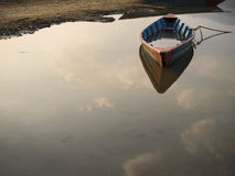 Rowboat Floating on Still Waters. Rowboat floating on the still waters of Phewa lake in Pokhara, Nepal Stock Photography