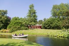Rowboat in Frederiksberg Park, Denmark. Frederiksberg, Denmark - June 07, 2016: People on a rowboat tour in Frederiksberg Park stock image