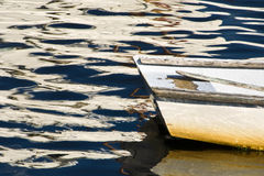 Rowboat in Late Afternoon Water with Reflections Royalty Free Stock Image