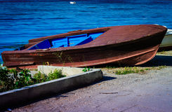 Rowboat Left On The Shore Royalty Free Stock Photo