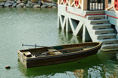 Rowboat beside marina stairs Stock Photos