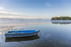Rowboat on a Misty Lake in Autumn - Ontario, Canada Stock Photography
