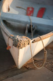 Rowboat and Oars at sunset. Colorful image of a new england row boat or skiff at sunset sitting on a wooden dock Stock Images