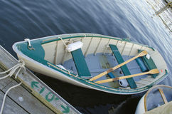 Rowboat. A rowboat with oars tied up at a dock Stock Images