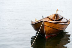 Rowboat in Oslo. Old wooden row boat on water Stock Image