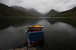 Rowboat on a pristine alpine lake Stock Images