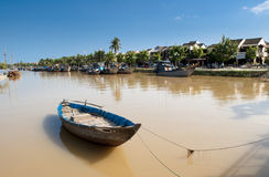 Rowboat on the river with the ancient town at background Stock Photography