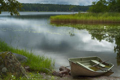 Rowboat at shore Stock Photo