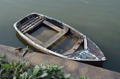 Rowboat sinking. Rowboat on the river Thames near Richmond, England Stock Photos