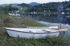 Boat by Solina shore. Rowboat by Solina shore near Polanczyk. Small boat for fisherman stock images