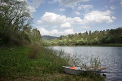 Skiff by Solina shore in Spring time. Rowboat by Solina shore in Spring time stock photo