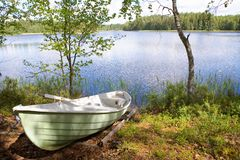 Rowboat stranded ashore Stock Photo