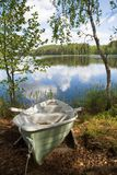 Rowboat stranded ashore. At a lake in Finland Royalty Free Stock Photos