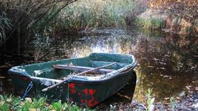 Rowboat in the swamp royalty free stock photography