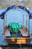 Rowboat to transport passengers on Lake Bled in Slovenia in Euro Royalty Free Stock Images