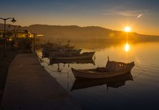 A rowboat watches an amazing sunset Stock Photography