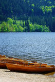 Rowboats on the banks of Lake Titisee Stock Images
