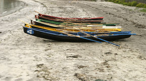 Rowboats On The Beach. Six numbered and brightly colored rowboats on the main beach on the Aran Islands are lined up. These boats are to be used in a set of Royalty Free Stock Images