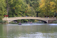 Rowboats in Central Park. New York City, NY, USA - October 9, 2015: Rowboats on The Lake in front of the Bow Bridge in Central Park, New York City, New York, USA Stock Image