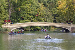 Rowboats in Central Park. New York City, NY, USA - October 9, 2015: Rowboats on The Lake in front of the Bow Bridge in Central Park, New York City, New York, USA Stock Photo