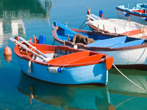 Rowboats in clear sea. Royalty Free Stock Photos
