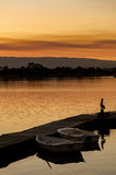 Rowboats at dock in California at sunset. Peaceful rowboats on calm lake with Pelican standing by at Sunset Stock Photography