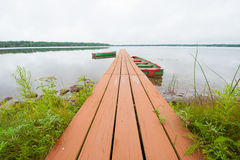 Rowboats and Dock. Rowboats docked on a lake stock photography
