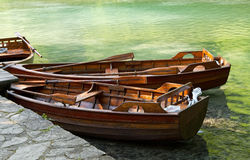 Rowboats on green lake. Wooden rowboats tied up on green lake stock photos