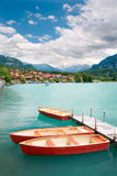 Rowboats on Lake Brienz, Berne Canton, Switzerland. Rowboats on Lake Brienz in the district of Interlaken in the canton of Berne in Switzerland Stock Image