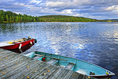 Rowboats on lake at dusk. Rowboats docked on Lake of Two Rivers in Algonquin Park, Ontario, Canada Royalty Free Stock Photo