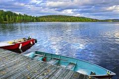 Rowboats on lake at dusk royalty free stock photo