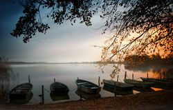 Rowboats on the lake shore before sunrise, scenic landscape with copy space, selected focus royalty free stock images