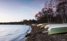 Rowboats on the lakeside. Rowboats on lakeside at autumn evening Stock Images
