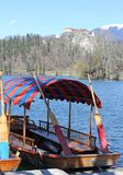 Rowboats moored on the shore of Lake Bled in Slovenia and the ca Stock Photo