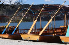 Rowboats moored on the shore of Lake Bled in Slovenia and the Ch Royalty Free Stock Photography