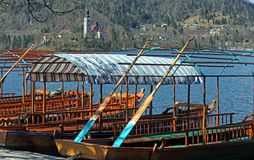 Rowboats moored on the shore of Lake Bled in Slovenia Stock Photos